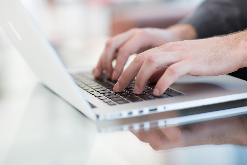 work-on-a-laptop-as-always-the-programmer-pretends-K8ANL33